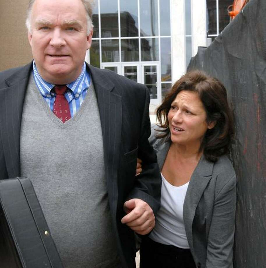 Attorney Richard Marquette left and Donna Bello leaving Hartford Federal Court after she was arraigned in a pyramid scheme called Women's Gifting Table.  Mara Lavitt/New Haven Register5/2/12