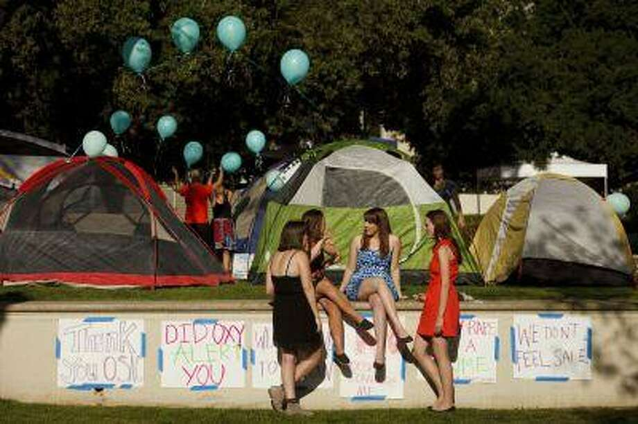 Carly Mee (center), a student at Occidental College, talks with other students during the Oxy Sexual Assault Coalition's awareness night campout at the college campus in Los Angeles.