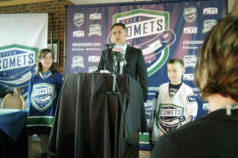 JESSI PIERCE - ONEIDA DISPATCH Vancouver Canucks Assistant General Manager Laurence Gilman reveals Utica Comets logo and jerseys on June 14, 2013.