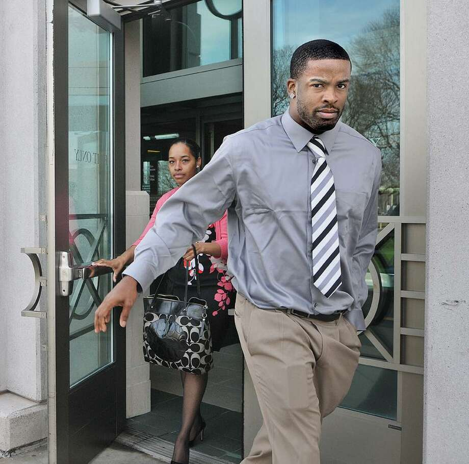 Catherine Avalone/The Middletown Press Middletown city native Amari Spievey exits Middlesex Superior Court in Middletown Thursday morning. / TheMiddletownPress