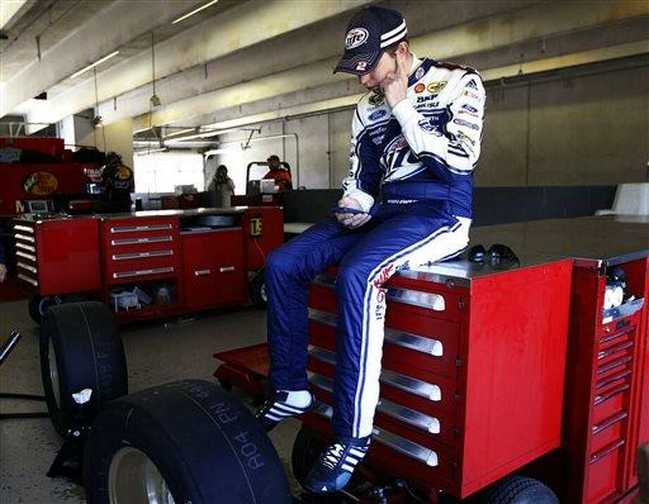 Brad Keselowski takes a break between laps during testing at Texas Motor Speedway, Thursday, April 11, 2013, in Fort Worth,Texas. The NASCAR Sprint Cup Series NRA 500 auto race is scheduled to run Saturday, April 13. (AP Photo/The Fort Worth Star-Telegram, Ron Jenkins) Photo: AP / The Fort Worth Star-Telegram