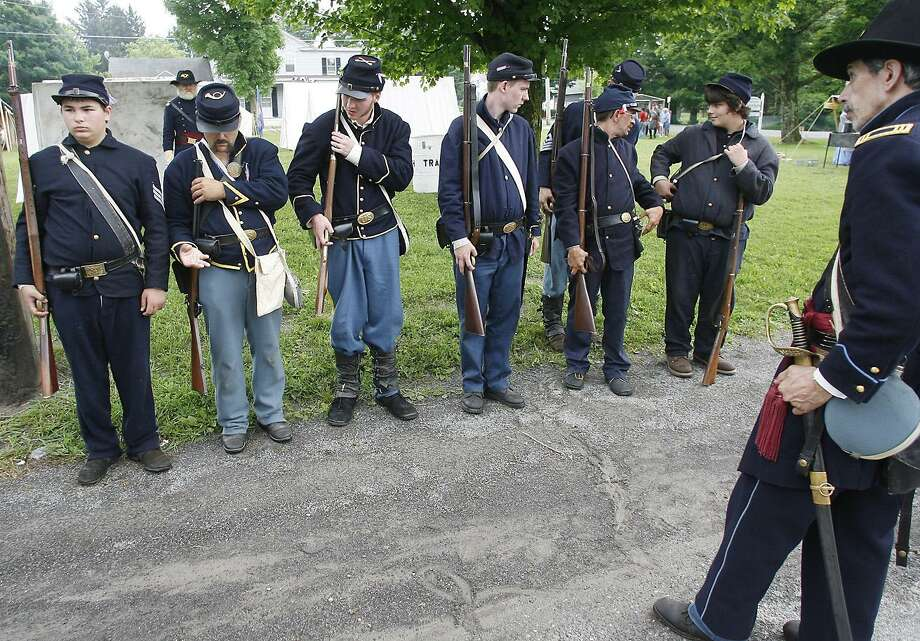 JOHN HAEGER @ONEIDAPHOTO ON TWITTER/ONEIDA DAILY DISPATCH -- Union soldiers ready for battle in Peterboro during the Civil War Weekend on Saturday, June 11, 2011.