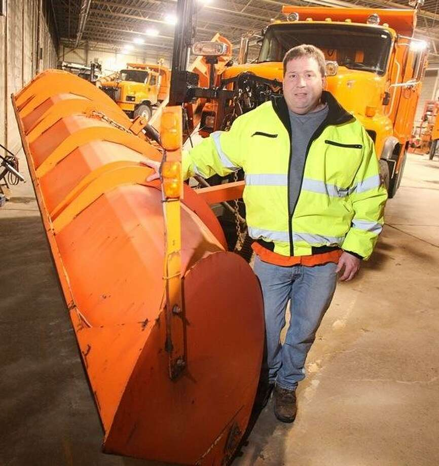 JOHN HAEGER @oneidaphoto on Twitter/Oneida Daily Dispatch Richard Durant of the Madison County Highway Department stands next to a snowplow at the garage in Wampsville. Photo: Oneida Daily Dispatch / Oneida Daily Dispatch