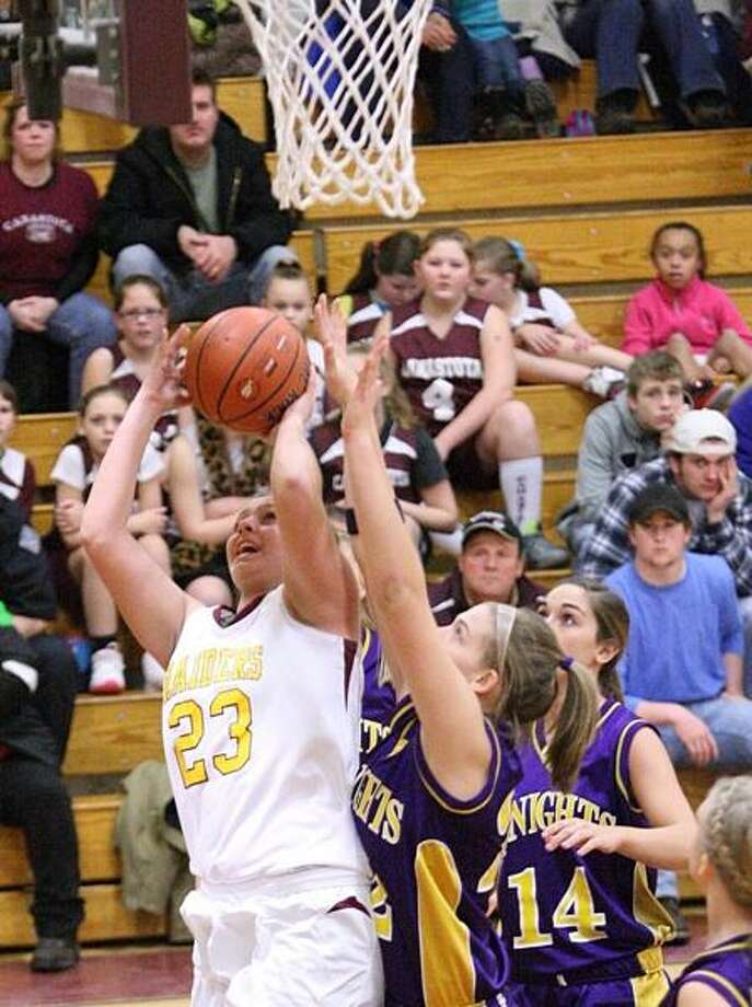 Dispatch Staff Photo by JOHN HAEGER (Twitter: @OneidaPhoto) Canastota's Shea Foster (23) goes up for a shot as Holland Patent's Allyson Freiermuth (22) defends in the first half of the game in Canastota on Wednesday, Feb. 6, 2013.