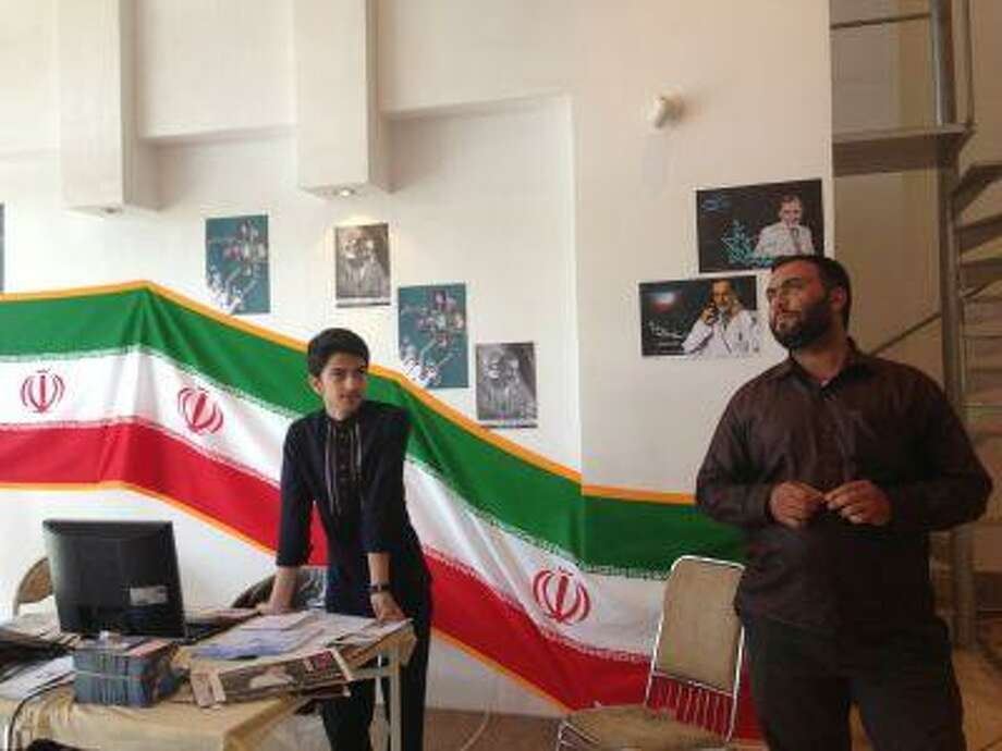 Only two teenage volunteers, one of them too young to vote, manned the campaign office of Iranian presidential candidate Ali Akbar Velayati on Monday in Qoms, Iran. Photo: The Washington Post / The Washington Post