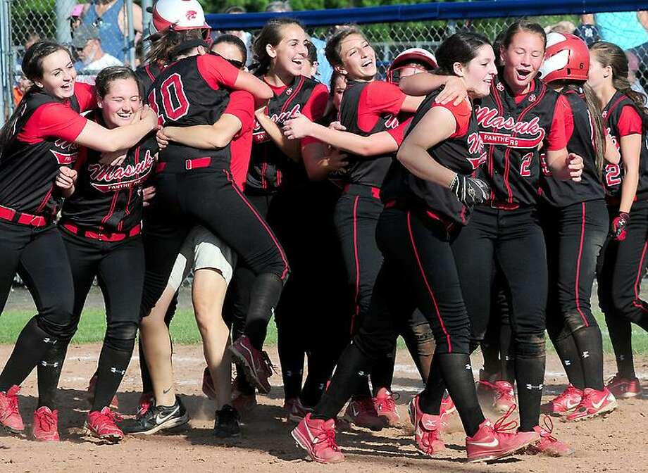 Arnold Gold -- RegisterMasuk celebrates their seventh inning come from behind 3-2 win over Foran in the CIAC Class L Softball Championship  in West Haven on 6/12/2013.