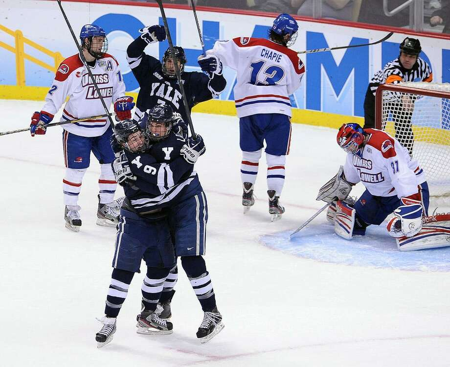 """Pittsburgh, PA-- Yale Celebrates their second goal in the first period against UMASS- Lowell. Photo-Peter Casolino/Register <a href=""""mailto:pcasolino@newhavenregister.com"""">pcasolino@newhavenregister.com</a>"""