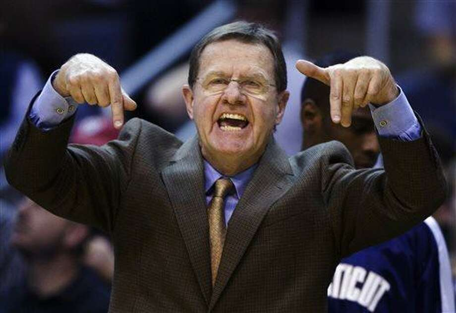 FILE - In this Jan. 12, 2008 file photo, Connecticut associate head coach George Blaney yells out instructions during the second half of a basketball game against Georgetown in Washington. Blaney has announced an end to his 43-year coaching career, retiring after 12 seasons as an assistant at Connecticut.  (AP Photo/Manuel Balce Ceneta, File) Photo: AP / AP