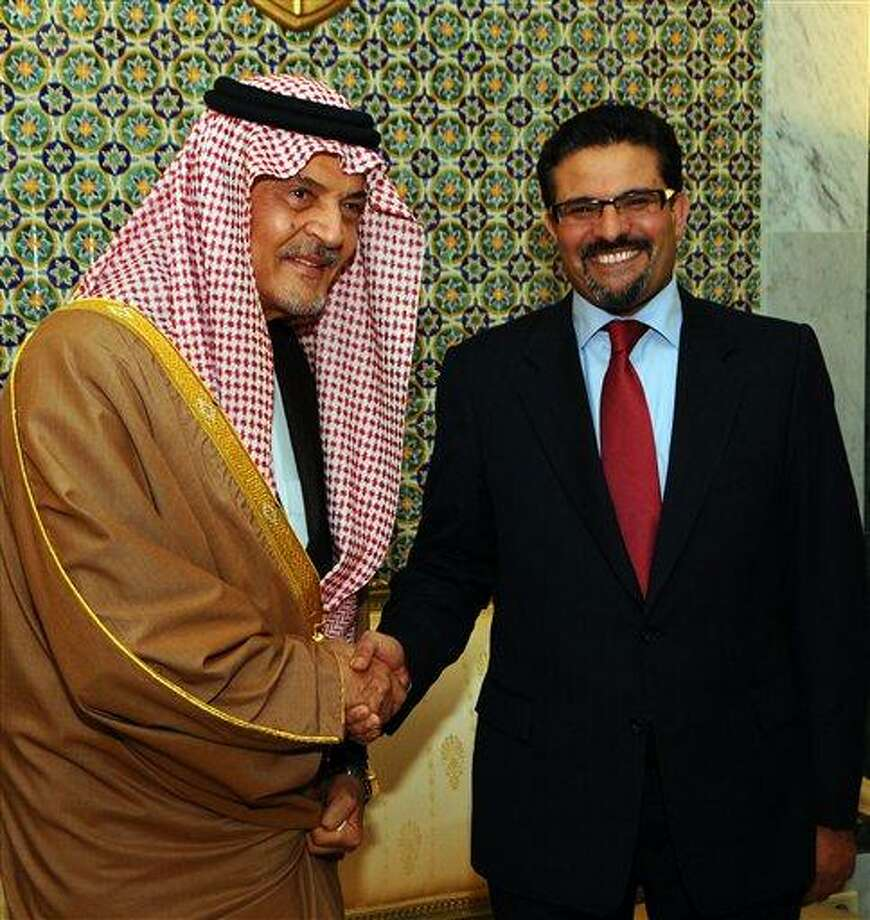 Tunisia's Foreign Minister Rafik Abdessalem, right, shakes hands with his Saudi counterpart, Saud bin Faisal bin Abdulaziz Al Saud, in Tunis, Tuesday, Jan, 29, 2013. (AP Photo/Hassene Dridi) Photo: AP / AP