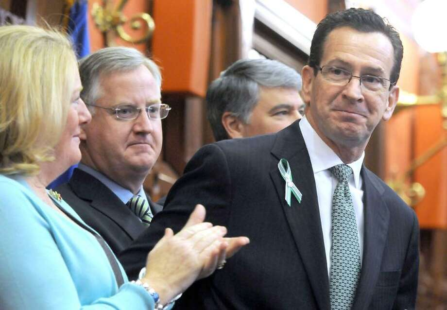 Gov. Dannel P. Malloy after his biennial budget address to the CT state legislature. His wife Cathy is at left, then House Speaker Brendan Sharkey, D-88, Senate President Pro Tempore Donald Williams, Jr. D-29. Mara Lavitt/New Haven Register2/6/13