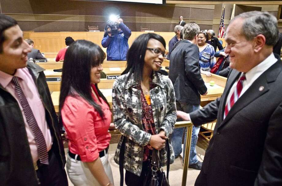 New Haven-Left to right: Jordy Padilla, UNH;  Priscilla Maldonado, Quinnipiac;  Adisa John, Southern;  talk with Mayor John DeStefano after the Staye of the City Adress..  All three students are sophmores attending college on  Promise scholarships    Melanie Stengel/Register