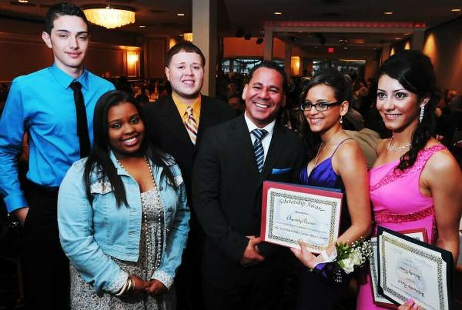 Mara Lavitt/New Haven Register  On June 13, 2013 at Anthony's Ocean View in New Haven, the New Haven Hispanic Firefighters in partnership with the Latino Officers Society (New Haven Police Dept.) awarded scholarships to five New Haven high school students, left to right: Christian Jovani Colon, Mariliz Maysonet, Joel Ortiz, New Haven Hispanic Firefighters Assoc. president Felipe Cordero, Chastity Berrios, and Solanly Canas.