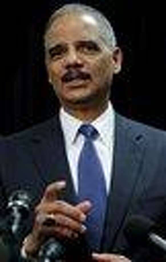In this file photo, U.S. Attorney General Eric Holder speaks at a press conference in November about the 2010 Gulf Oil Spill settlement and criminal penalties at 400 Poydras Tower in the Central Business District of in New Orleans, La.  (AP Photo/Matthew Hinton) Photo: AP / FR170690 AP