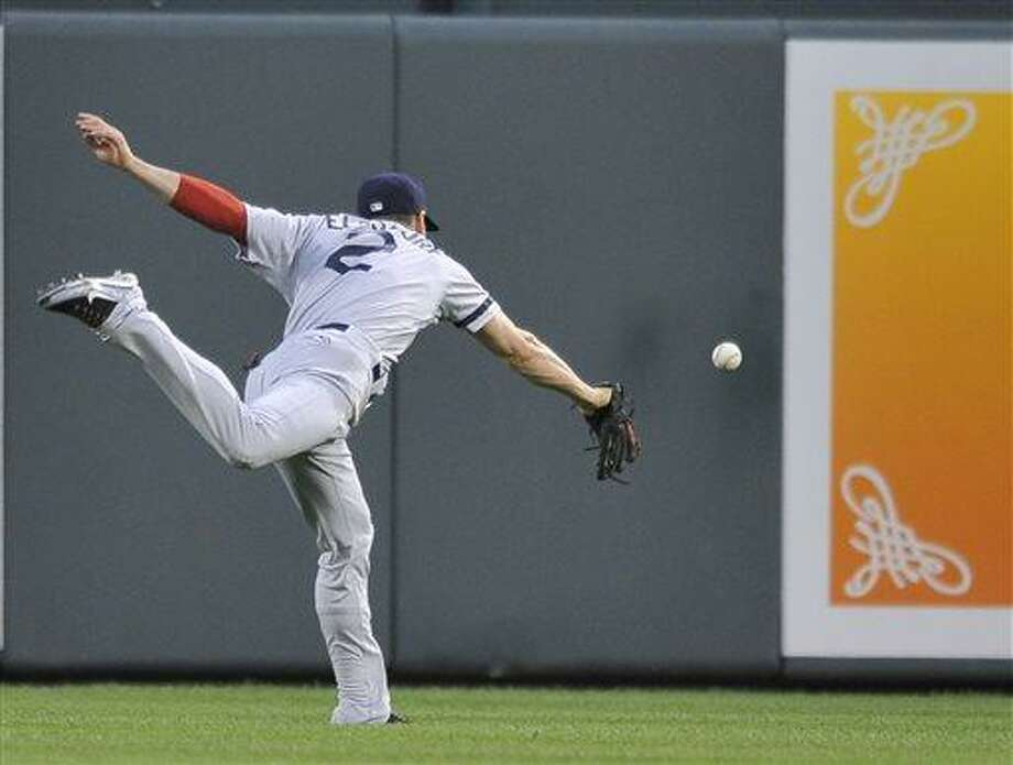 Boston Red Sox center fielder Jacoby Ellsbury is unable to catch up with a ball hit by Baltimore Orioles Danny Valencis in the fourth inning of a baseball game Thursday, June 13, 2013, in Baltimore. Valencia earned a double on the play.(AP Photo/Gail Burton) Photo: AP / FR4095 AP