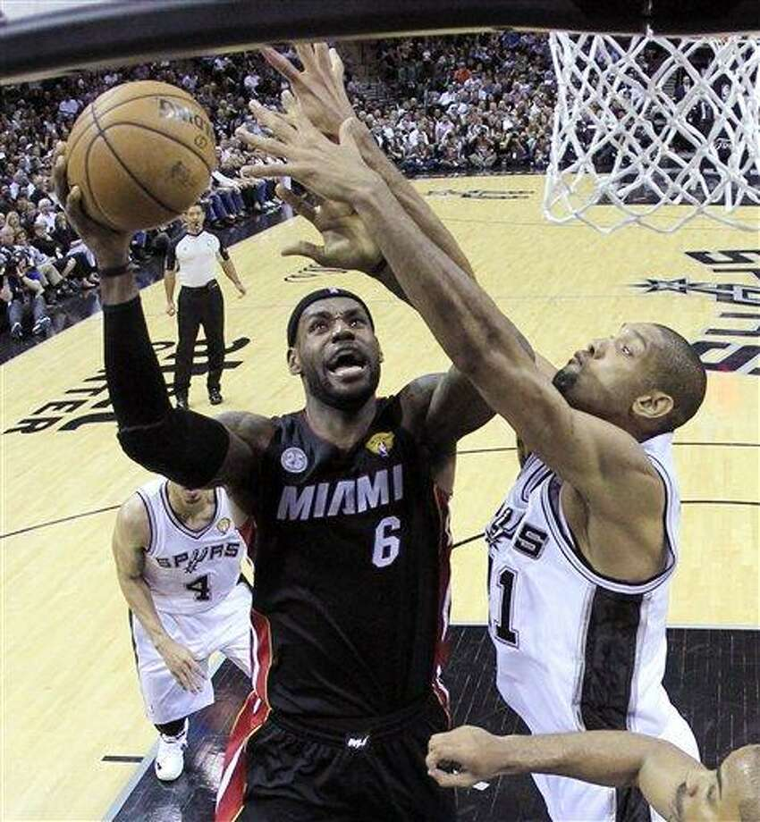 Miami Heat's LeBron James (6) shoots as San Antonio Spurs' Tim Duncan (21) defends during the first half at Game 4 of the NBA Finals basketball series, Thursday, June 13, 2013, in San Antonio. (AP Photo/Lucy Nicholson) Photo: ASSOCIATED PRESS / AP2013