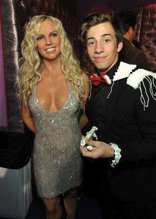 """Jimmy Bennett, right, poses with a wax figure of Britney Spears at the after party for the LA premiere of """"Movie 43"""" at Madame Tussauds on Wednesday, Jan. 23, 2013, in Los Angeles. (Photo by John Shearer/Invision/AP) Photo: John Shearer/Invision/AP / Invision"""