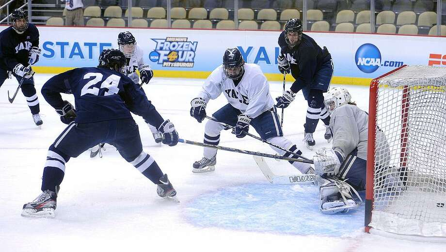 """Pittsburg, PA-- Yale during a practice at the Consol Energy Center in Pittsburg, PA as they prepare for the Frozen Four finals.  Photo-Peter Casolino/Register <a href=""""mailto:pcasolino@newhavenregister.com"""">pcasolino@newhavenregister.com</a>"""