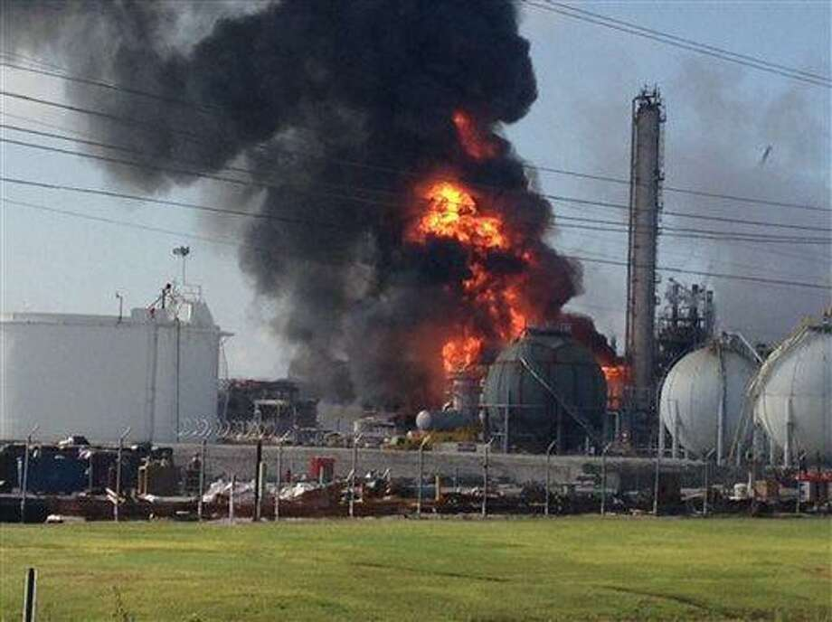 This photo provided by Ryan Meador shows an explosion at The Williams Companies Inc. plant in the Ascension Parish town of Geismar La., Thursday, June 13, 2013. The fire broke out Thursday morning at the plant, which the company's website says puts out about 1.3 billion pounds of ethylene and 90 million pounds of polymer grade propylene a year. (AP Photo/Ryan Meador) Photo: AP / AP
