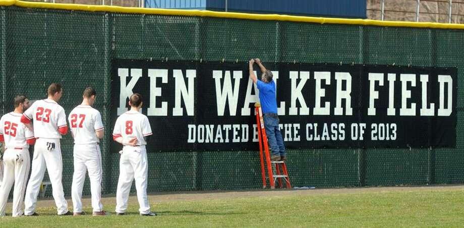 The baseball field at Foran High School was named in honor of former longtime coach Ken Walker during a pregame ceremony. Walker died last June. Mara Lavitt/New Haven Register