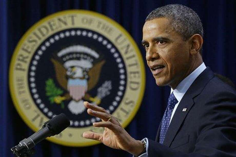 "President Barack Obama gestures as he speaks about the fiscal cliff, Monday, Dec. 31, 2012, in the South Court Auditorium at the White House in Washington. The president said it appears that an agreement to avoid the fiscal cliff is ""in sight,"" but says it's not yet complete and work continues.  (AP Photo/Charles Dharapak) Photo: AP / AP"