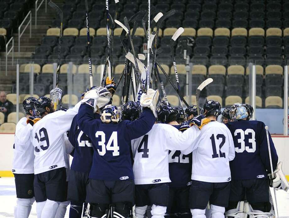 "Pittsburg, PA--  Quinnipiac gets pumped up as they finish their practice at the Consol Energy Center in Pittsburg, PA as they prepare for the Frozen Four finals.  Photo-Peter Casolino/Register <a href=""mailto:pcasolino@newhavenregister.com"">pcasolino@newhavenregister.com</a>"