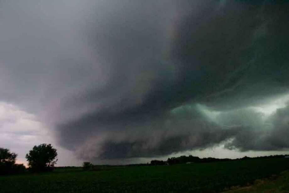 A wall cloud, containing a reported funnel cloud, passes over the Wanatah, Ind. area as a line of severe storm moves through the area Wednesday June 12, 2013. (AP Photo/The LaPorte Herald-Argus, Bob Wellinski) Photo: AP / LaPorte Herald Argus
