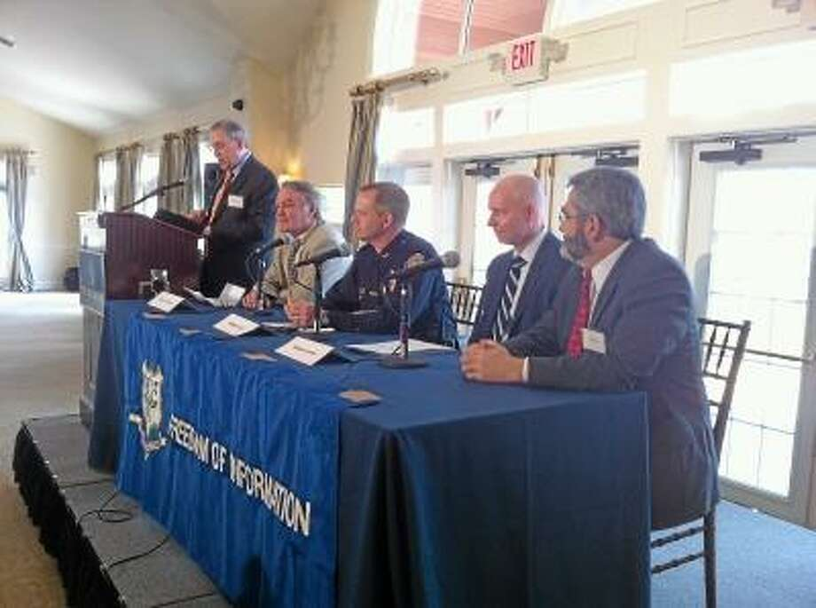 Viktoria Sundqvist/The Middletown Press Moderator Steven Kalb asks questions of retired newspaper editor Jim Smith, South Windsor Police Chief Matt Reed, former legislator Michael Lawlor and attorney Dan Klau during the annual Freedom of Information conference at the Riverhouse at Goodspeed in Haddam on Tuesday.