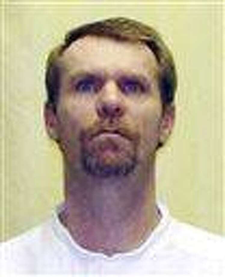 This undated photo released by the Ohio Department of Rehabilitation and Corrections shows Steven Smith. Smith, a condemned Ohio killer is making an unusual plea for mercy ahead of his scheduled execution next month. Attorneys for Steven Smith tell the state parole board that while he intended to rape his girlfriend's 6-month-old daughter, Smith never intended to kill the girl. (AP Photo/Ohio Department of Rehabilitation and Corrections) Photo: AP / Ohio Department of Rehabilitatio