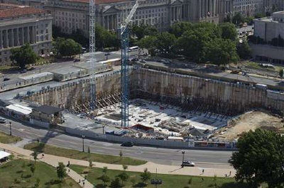 This photo taken June 2, 2013 shows the under-construction Smithsonian National Museum of African American History and Culture in Washington, Oprah Winfrey is giving $12 million to a museum being built on the National Mall that will document African-American life. The National Museum of African American History and Culture said the museum's 350-seat theater will be named after Winfrey. When it's finished in 2015, the museum will house artifacts including Harriet Tubman's shawl, Emmett Till's casket and a Jim Crow-era segregated railroad car. (AP Photo/Alex Brandon) Photo: AP / AP