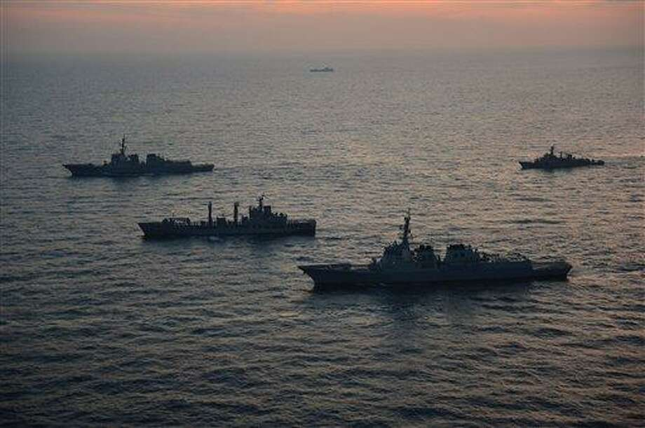 In this photo released by South Korean Joint Chiefs of Staff via Yonhap, South Korean and U.S. warships participate in their joint military drills in South Korea's East Sea on Monday, Feb. 4, 2013. South Korean and U.S. troops began naval drills Monday in a show of force partly directed at North Korea amid signs that Pyongyang will soon carry out a threat to conduct its third atomic test. (AP Photo/South Korean Joint Chiefs of Staff via Yonhap) KOREA OUT Photo: ASSOCIATED PRESS / AP2013