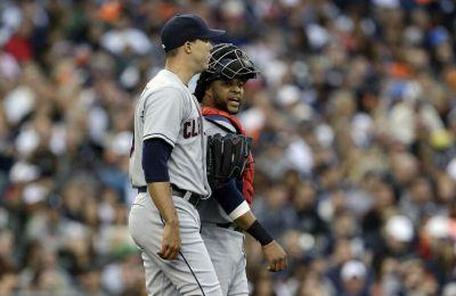 Cleveland Indians pitcher Ubaldo Jimenez, left, listens to catcher Carlos Santana against the Detroit Tigers in the second inning of a baseball game in Detroit, Mich., Friday, June 7, 2013. Photo: AP / AP