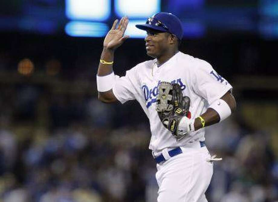 Los Angeles Dodgers right fielder Yasiel Puig after the Dodgers defeat the Atlanta Braves 5-0 during a baseball game Thursday, June 6, 2013, in Los Angeles. Photo: AP / FR170211 AP