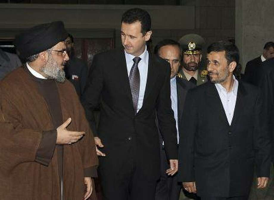Hezbollah leader sheik Hassan Nasrallah, left, speaks with Syrian President Bashar Assad, center, and Iranian President Mahmoud Ahmadinejad during a visit, in Damascus, Syria in 2010. Photo: ASSOCIATED PRESS / AP2013