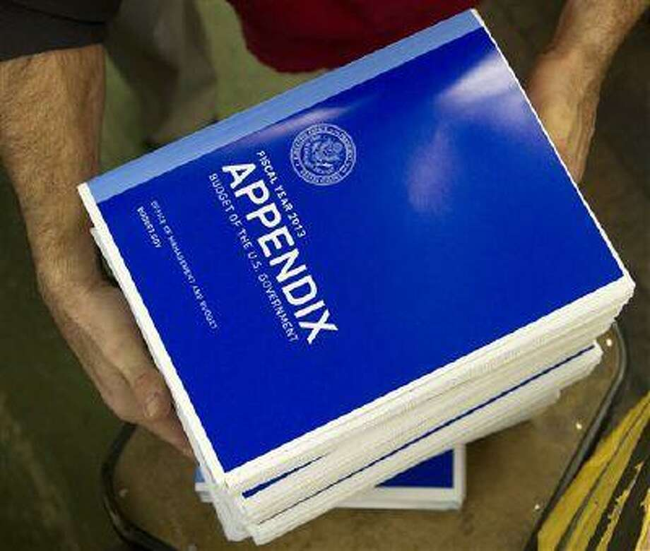 Copies of the a appendix of President Barack Obama's fiscal 2013 federal budget are readied at the Government Printing Office (GPO) in Washington, Thursday, Feb. 9, 2012. (AP Photo/Manuel Balce Ceneta) Photo: ASSOCIATED PRESS / AP2012