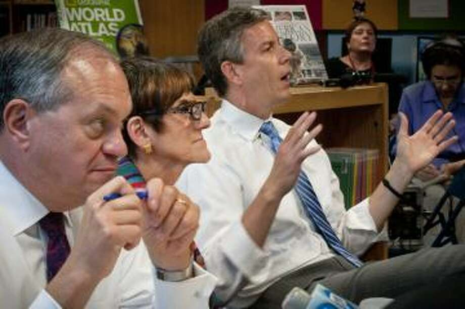 From left, Mayor John DeStefano, Rep. Rosa DeLauro, and U.S. Education Secretary Arne Duncan participate in a round table discussion on education reform Tuesday, May 29, 2012 at Jepson School in New Haven, Conn. Connecticut was freed Tuesday from the strictest mandates of the federal No Child Left Behind education law after enacting a sweeping public school overhaul that won strong praise from the nation's top education official. (AP Photo/The New Haven Register, Melanie Stengel) Photo: ASSOCIATED PRESS / AP2012