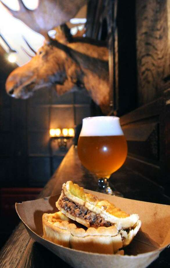 "The Aussie beef meat pie made by Sixpence Pie Co of Southington, with Four Mile River Farm (Old Lyme) beef at Ordinary, New Haven. The beer is a Belgian lager. Mara Lavitt/New Haven Register <a href=""mailto:mlavitt@newhavenregister.com"">mlavitt@newhavenregister.com</a>5/29/13"