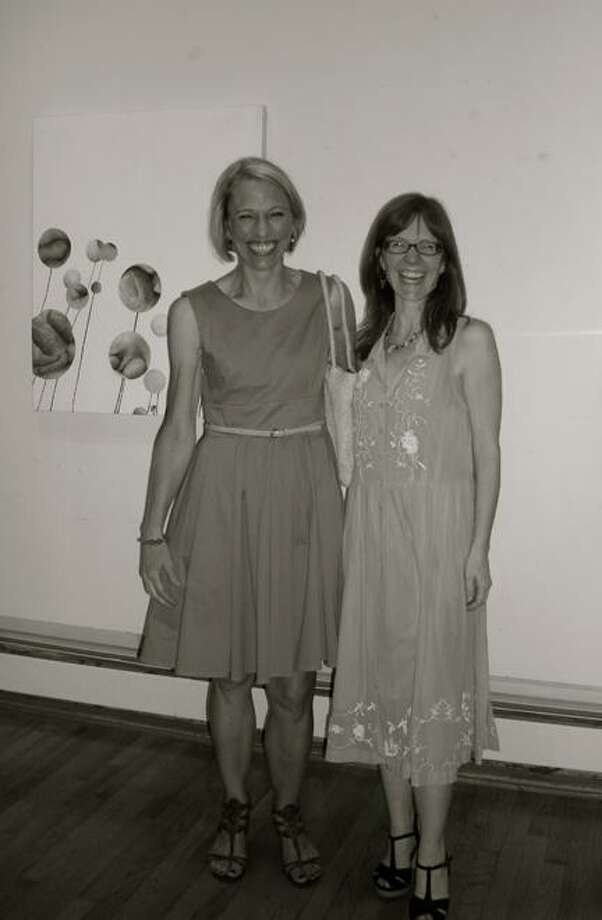 Photo Courtesy Kirkland Art Center KAC Executive Director Kathleen Teodoro, right, with April Oswald, chair of the KAC Exhibition Committee, at an art opening in the KAC Gallery in September 2012.