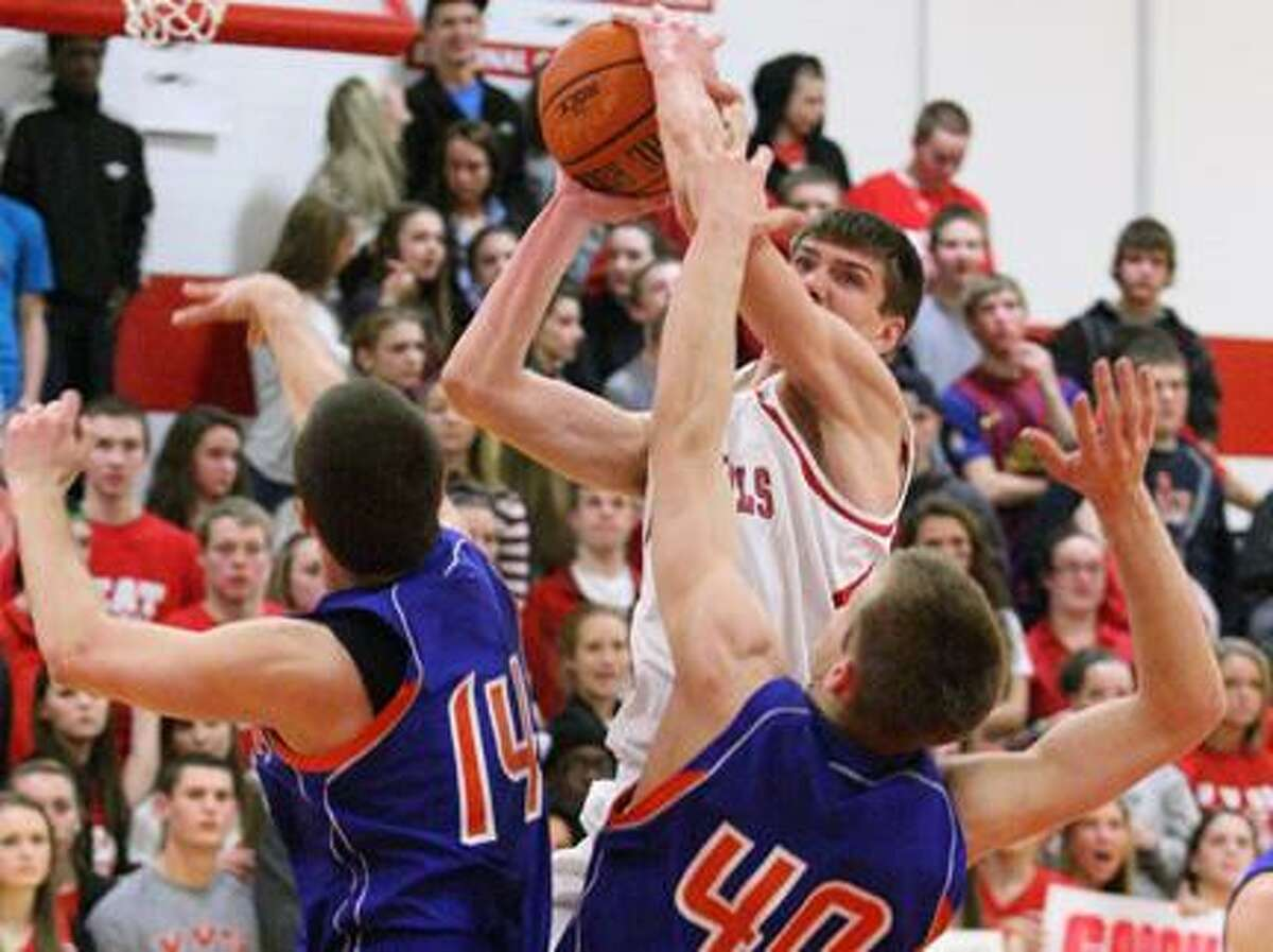 Dispatch Staff Photo by JOHN HAEGER (Twitter: @OneidaPhoto) VVS' Dalton Cousin (22) puts up a shot and is fouled by Oneida's Tyler Kuhn (40) as he and Matt Carinci (11) defend in the first half of their game in Verona on Tuesday, Feb. 5, 2013. Oneida won 68-61.