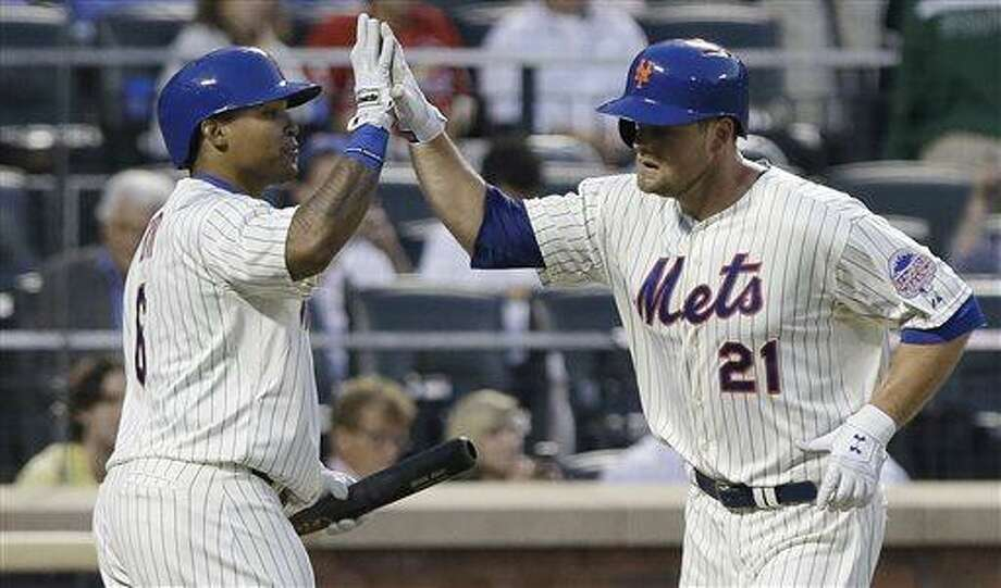 New York Mets' Lucas Duda (21) celebrates with with teammate Marlon Byrd (6) as he runs back to the dugout after hitting a home run during the fourth inning of a baseball game Wednesday, June 12, 2013, in New York.  (AP Photo/Frank Franklin II) Photo: AP / AP
