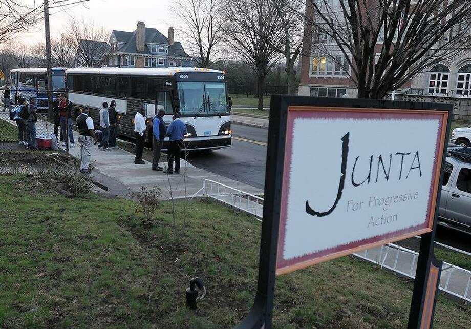 About 165 Connecticut residents meet at Junta for Progressive Action in New Haven early Wednesday morning to take buses to Washington, D.C., to attend a immigration reform rally. Peter Hvizdak/Register Photo: New Haven Register / ©Peter Hvizdak /  New Haven Register