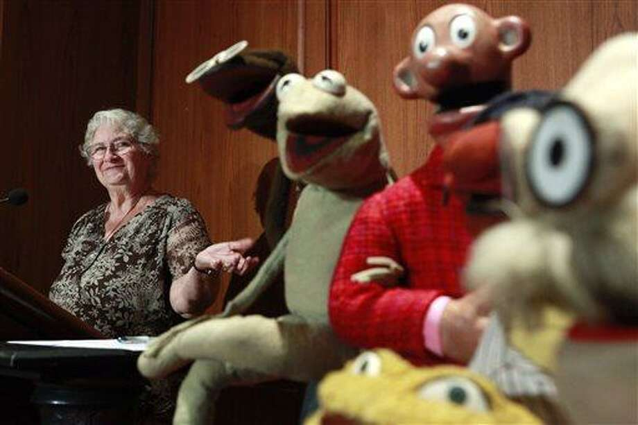 Jane Henson, left, donates some of Jim Henson's early puppets, including the original Kermit, to the Smithsonian Institution, during a ceremony in 2010 at the National Museum of American History, in Washington. Jane Henson died in her Connecticut home April 2 after a long battle with cancer. Associated Press file photo Photo: ASSOCIATED PRESS / A2010