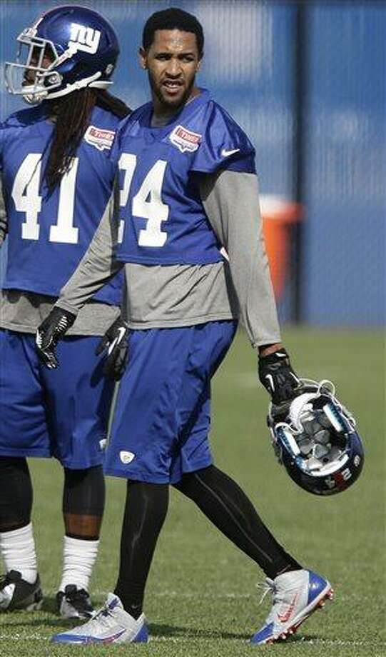 New York Giants' Terrell Thomas (24) walks on the field during mini camp Tuesday, June 11, 2013, in East Rutherford, N.J.  (AP Photo/Frank Franklin II) Photo: AP / AP