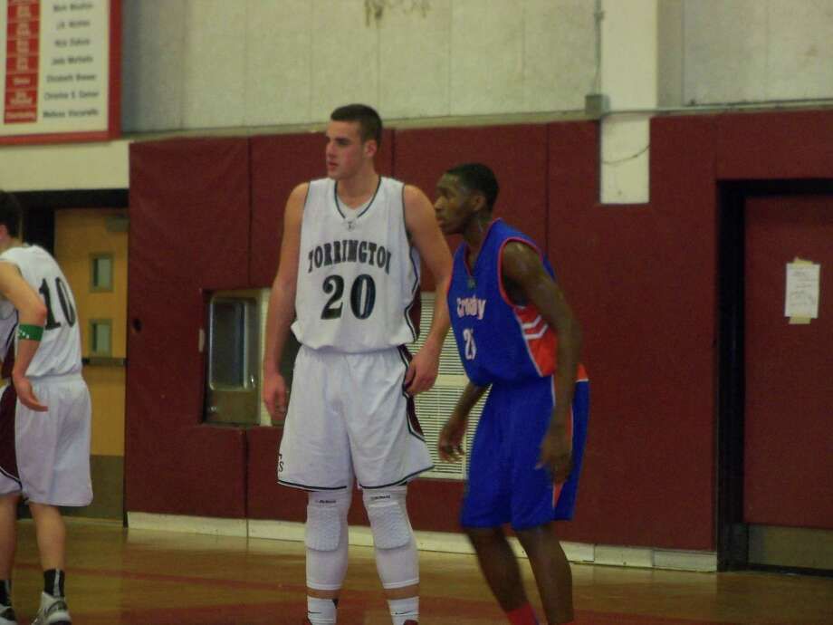 Torrington center Dave Canny lines up against Crosby center Devin Stallings. Canny scored 33 points in the loss. Photo by Peter Wallace/Register Citizen