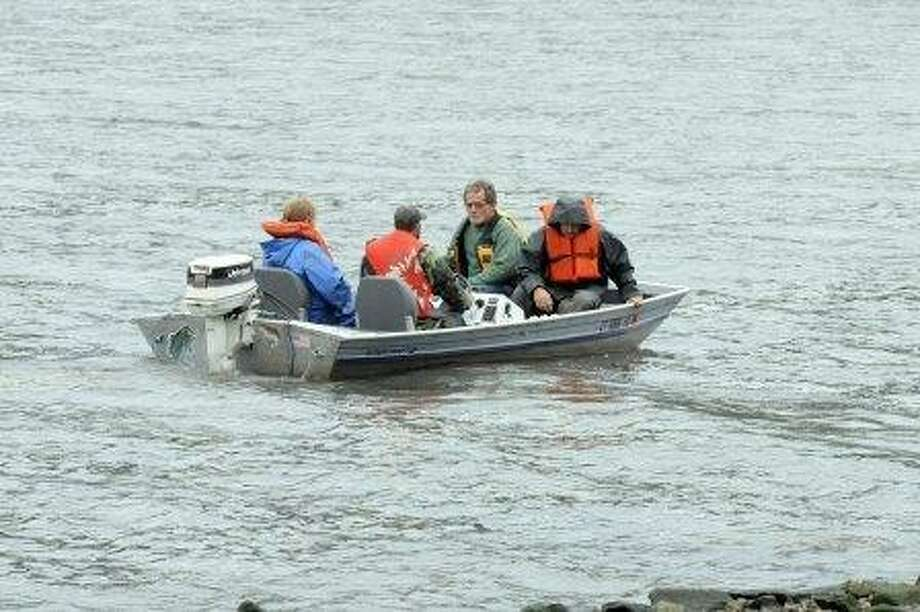 Volunteers search for missing photographer Eric Langlois on Lake Lillinonah in New Milford on Thursday, June 13, 2013. (Laurie Gaboardi - Litchfield County Times).