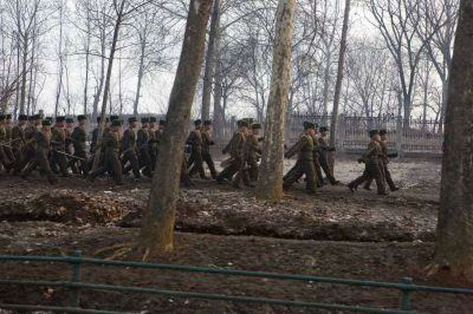 North Korean soldiers march along a highway on the edge of Pyongyang, North Korea on March 16, 2013. Photo: ASSOCIATED PRESS / AP2013