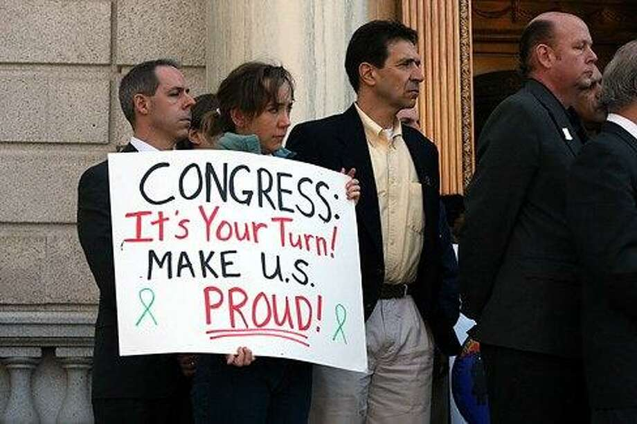 Members of the Newtown Action Alliance earlier this year prepare to head down to Washington D.C. to lobby Senators.