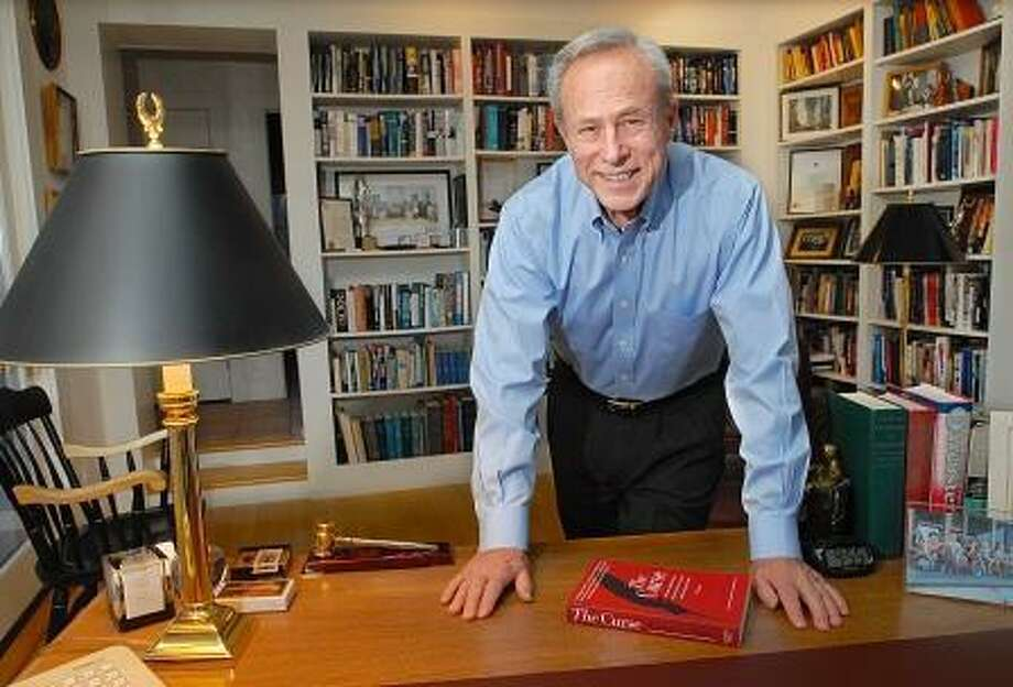 """Catherine Avalone/The Middletown Press  Former Congressman Robert Steele in his office at his Essex home is the author of """"The Curse: Big Time Gambling's Seduction of a Small New England Town."""" Mr. Steele's novel describes the wrenching when the federal government allowed two Indian casinos to open in eastern Connecticut."""