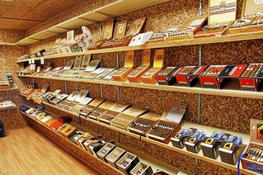 A selection of cigars inside the walk-in humidor at Tobacco Mart, a new tobacco shop at Torrington Plaza. Esteban L. Hernandez -- Register Citizen
