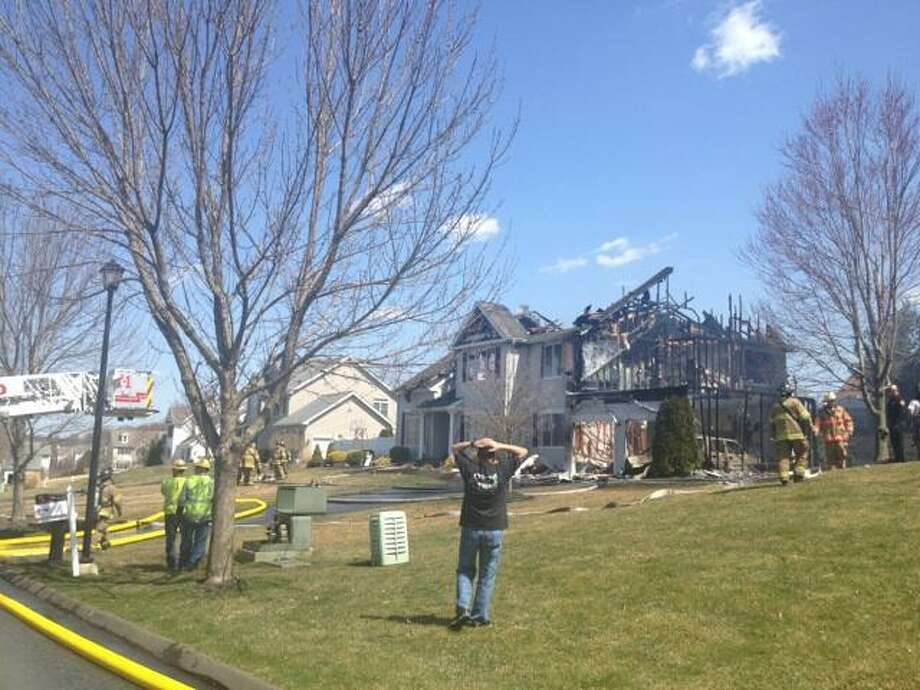 The scene of the house fire on Centennial Drive in Milford. Rachel Chinapen/Register