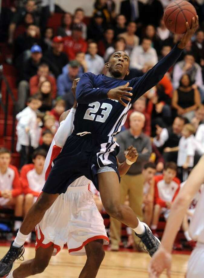 Hillhouse's Raiquan Clark goes up for a basket during the first meeting between No. 1 Hillhouse and No. 2 Fairfield Prep. (Mara Lavitt/Register file photo)